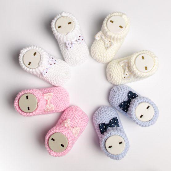 Botoși tricotați pentru bebeluși